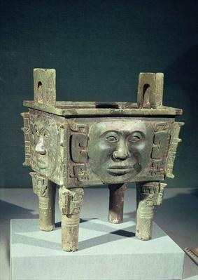 Rectangular 'ting' vessel with human faces, from Ninghsiang, Hunan Province, 14th-12th century BC (bronze)