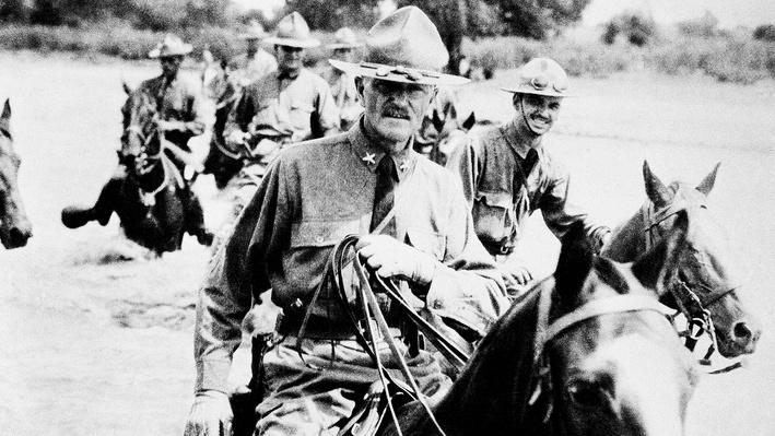 Photograph of Pershing and soldiers on horseback in Mexico looking for Pancho Villa
