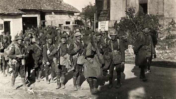 Photograph of American soldiers moving to the front lines