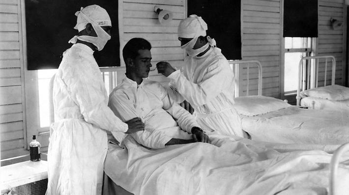 Photograph of a soldier receiving treatment in an army hospital