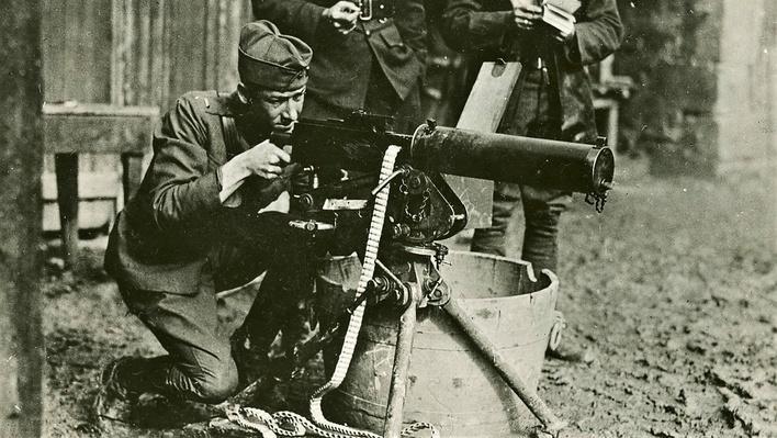 Photograph of an american soldier firing a browning machine gun