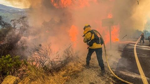 Raging Calif. wildfires strand people, prompt power outages