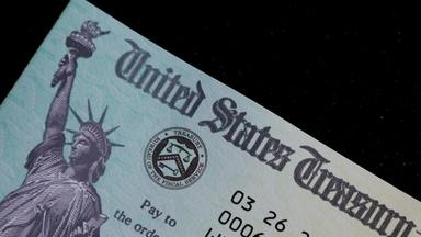 How did the stimulus checks impact everyday Americans?