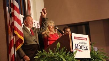 Roy Moore allegations shake Washington, Trump visits Asia