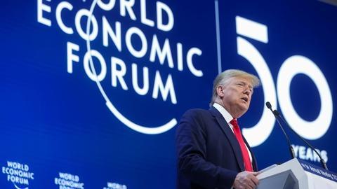 PBS NewsHour -- In Davos, Trump hails U.S. 'economic boom,' downplays trial