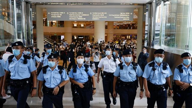 Hong Kong residents worry immigration law may ban their exit
