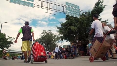 PBS NewsHour -- As Venezuela's economy plummets, mass exodus ensues
