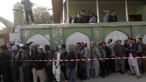 PBS NewsHour -- Millions vote in Afghanistan's long-delayed election
