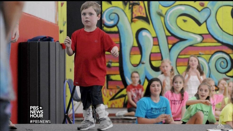 Kid 'superman,' born with heart defect, radiates strength image