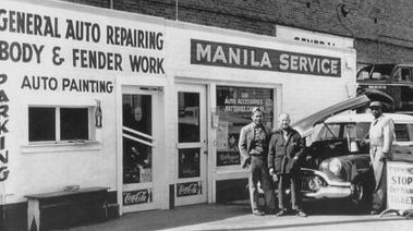 Black and white photo of Filipino owned garage