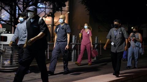 PBS NewsHour -- 'Help us out': Nurse begs Texans to wear face masks