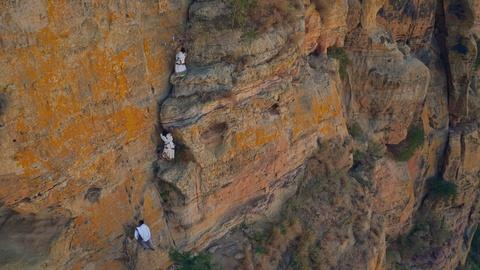 Earth's Natural Wonders -- In Ethiopia Villagers Climb Sheer Cliffs for a Baptism