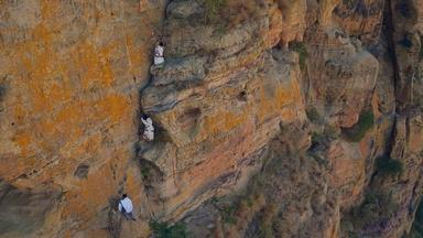 In Ethiopia Villagers Climb Sheer Cliffs for a Baptism