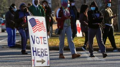 Georgia voters head to the polls, Senate control at stake