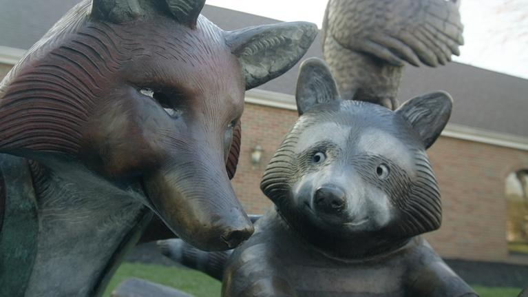 Broad and High: Mike Tizzano's Reading with Friends Sculpture