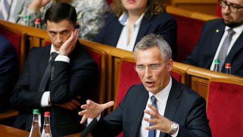 PBS NewsHour -- News Wrap: NATO chief demands Russian troops leave Ukraine