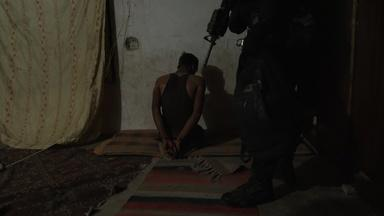 Watch Iraq's counterterrorism unit raid an ISIS agent's home