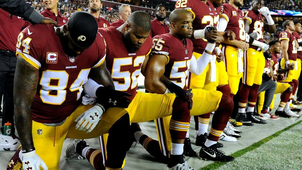 NFL players team up in defiance and solidarity image