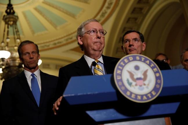 Lacking enough GOP votes, Senate pushes back health bill