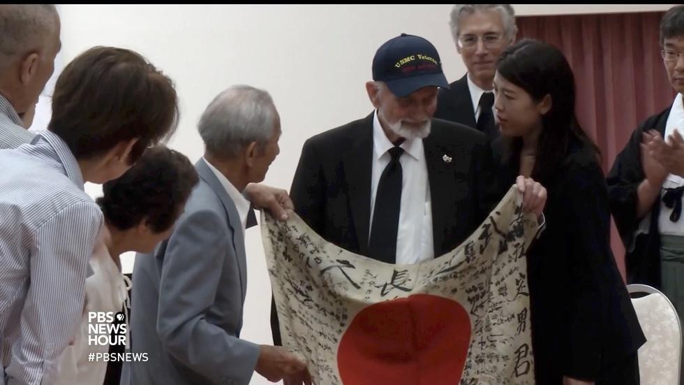 WWII veteran returns a fallen soldier's family keepsake image