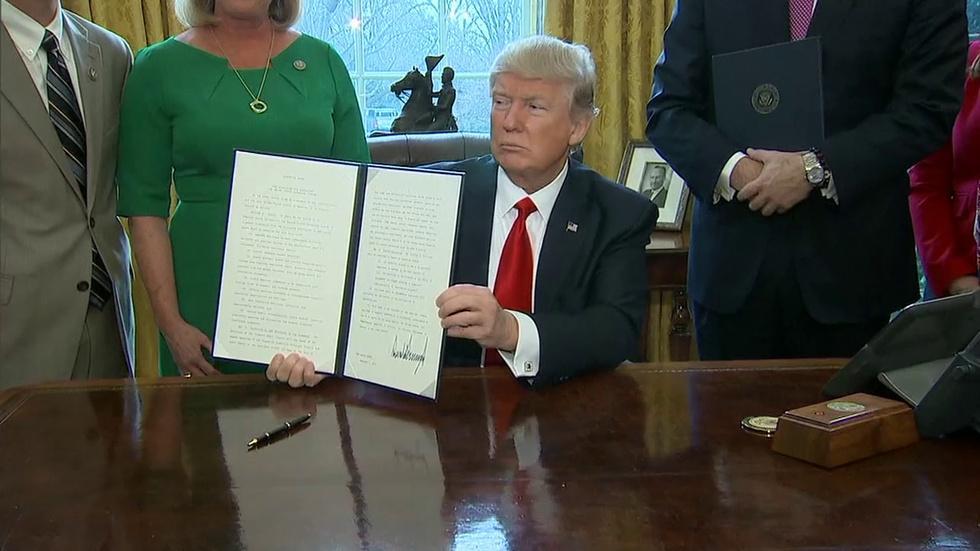 Trump's Economy: Is Less Regulation Better? image