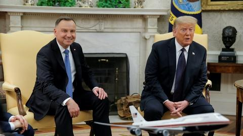 With Polish president, Trump reiterates plan to move troops