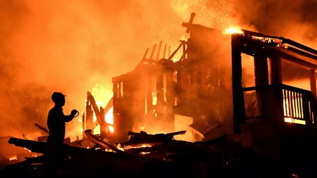 News Wrap: Dozens of wildfires still burning on West Coast