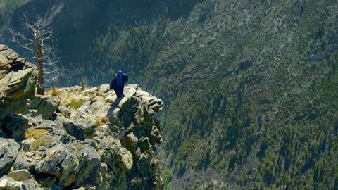 A Wingsuit Flyer Soars Down the Rockies