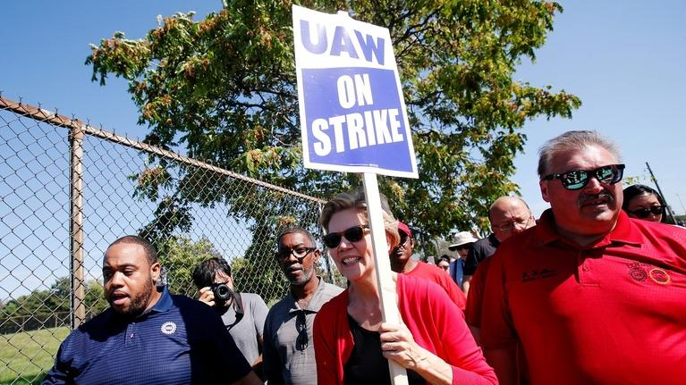 PBS NewsHour: Elizabeth Warren joins GM picket line as strike enters day 7