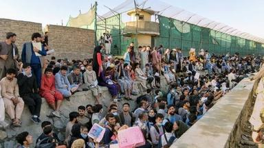 Afghan evacuees wait hours in the heat due to Kabul backlog