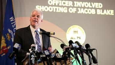 News Wrap: White officer avoids charges in Blake shooting