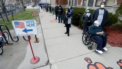PBS NewsHour   2 views on Wisconsin's holding in-person voting Tuesday