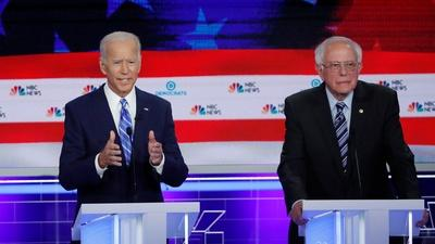 PBS NewsHour | Biden and Sanders clash over health care proposals