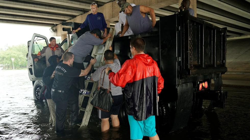 Texas rescuers work around the clock in unrelenting storm image