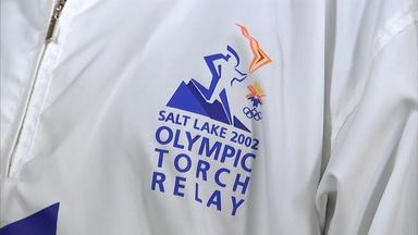 Appraisal: 2002 Salt Lake City Olympic Torch & Runners Suit