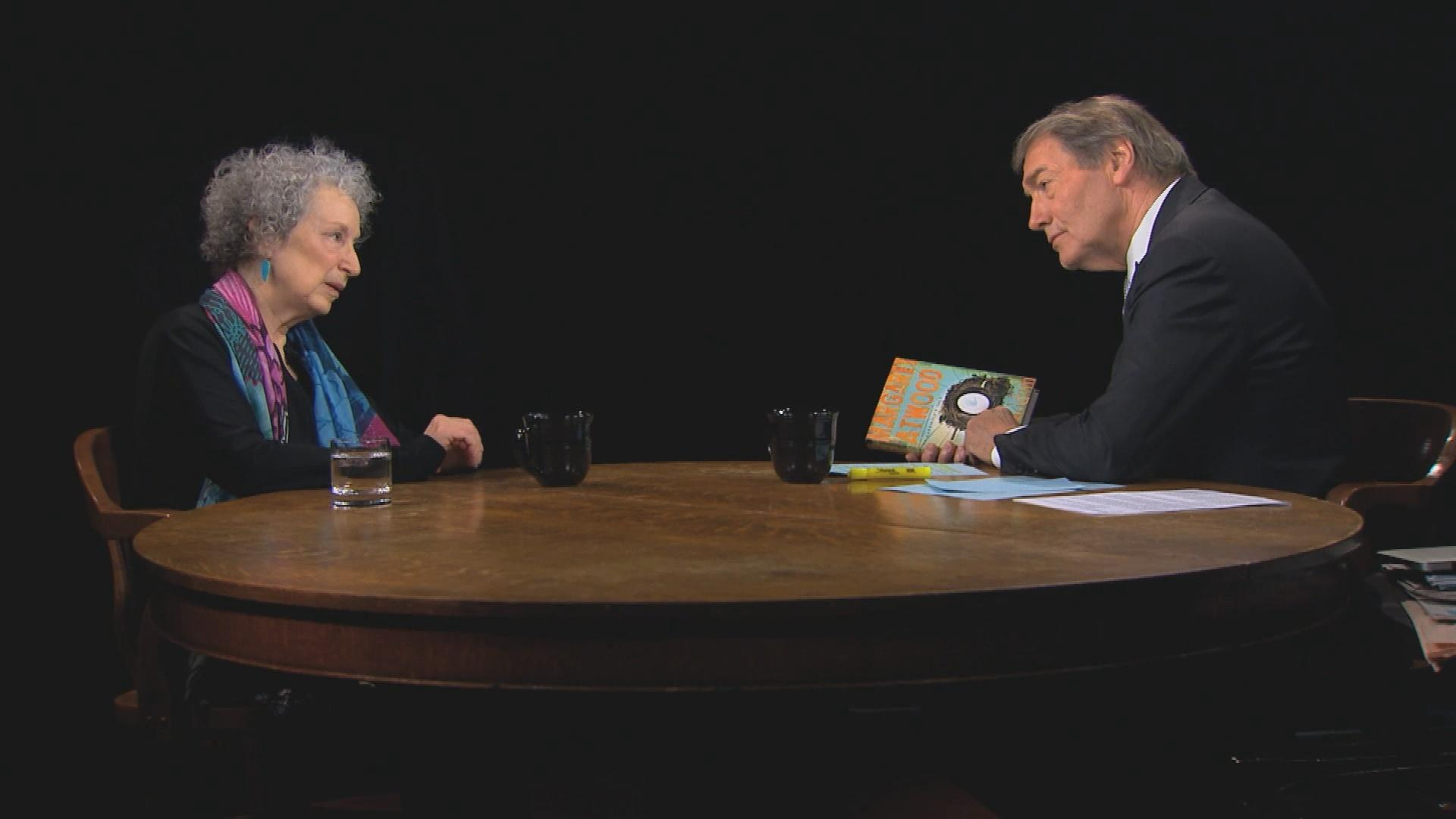 Image result for charlie rose at his table