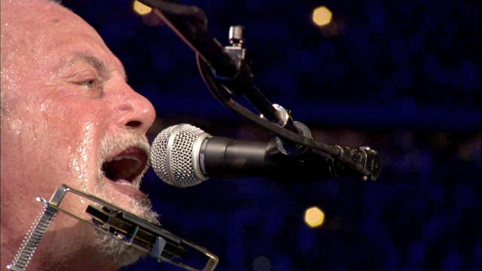 "Billy Joel performs ""Piano Man"" at Shea Stadium image"
