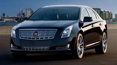 2013 Cadillac XTS & 2012 BMW 3 Series