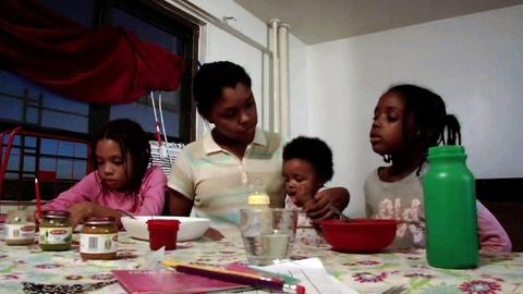 PBS NewsHour -- One NYC family's struggle to survive on a fast food salary