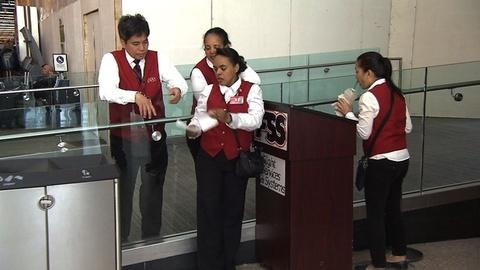 PBS NewsHour -- The Secret to Airport Workers not Losing Your Luggage