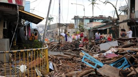 PBS NewsHour -- Debris continues to be obstacle to typhoon relief efforts