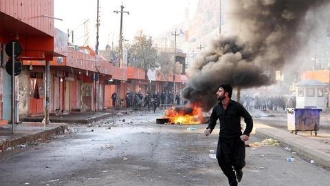 PBS NewsHour -- Is latest sectarian fighting in Iraq a misstep for al-Qaida?