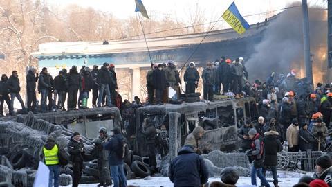 PBS NewsHour -- Protest riots spread across Ukraine