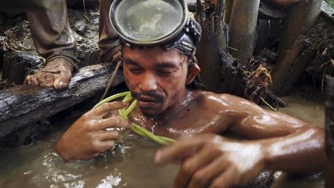 PBS NewsHour -- In Philippines, workers toil among hazards in compressor min