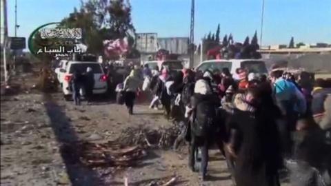 PBS NewsHour -- Homs evacuations continue amid delicate ceasefire