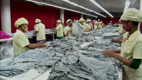 PBS NewsHour -- Can garment factories pay a living wage and still compete?
