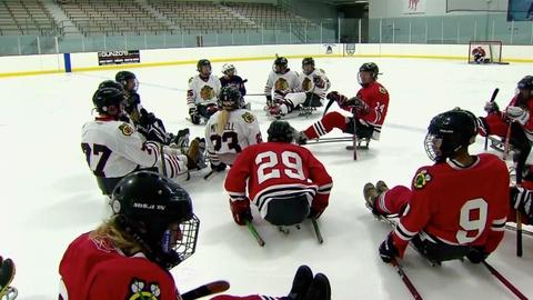 PBS NewsHour -- For Paralympic players, a hockey game with sleds