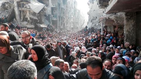 PBS NewsHour -- Aid groups prepare for long-term crisis in Syria