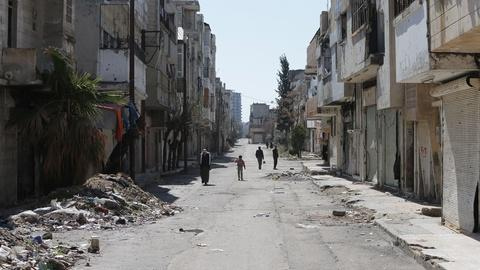 PBS NewsHour -- Looking inside Homs, central battlefield of Syria's war
