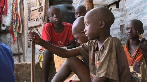 PBS NewsHour -- Thousands of Senegalese boys forced into begging system